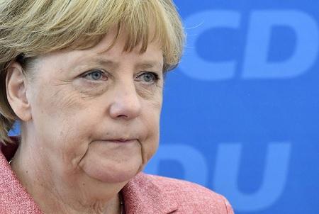 eff917b5983 Le parti de centre droit d Angela Merkel et son partenaire social-démocrate  de coalition à Berlin ont subi de sévères pertes lors d élections  régionales ...